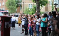 Praying at Grenfell tower
